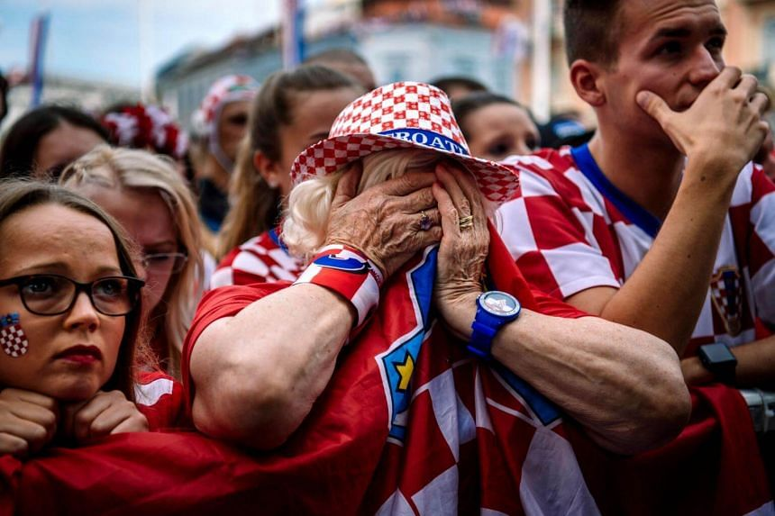 Croatian supporters in Zagreb reacting after the 2018 Russia World Cup final football match between Croatia and France, on July 15, 2018.