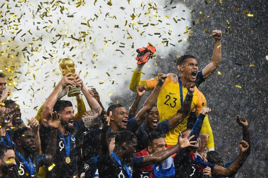 France's players lifting the World Cup trophy after winning the Russia 2018 World Cup final football match between France and Croatia at the Luzhniki Stadium in Moscow, on July 15, 2018.