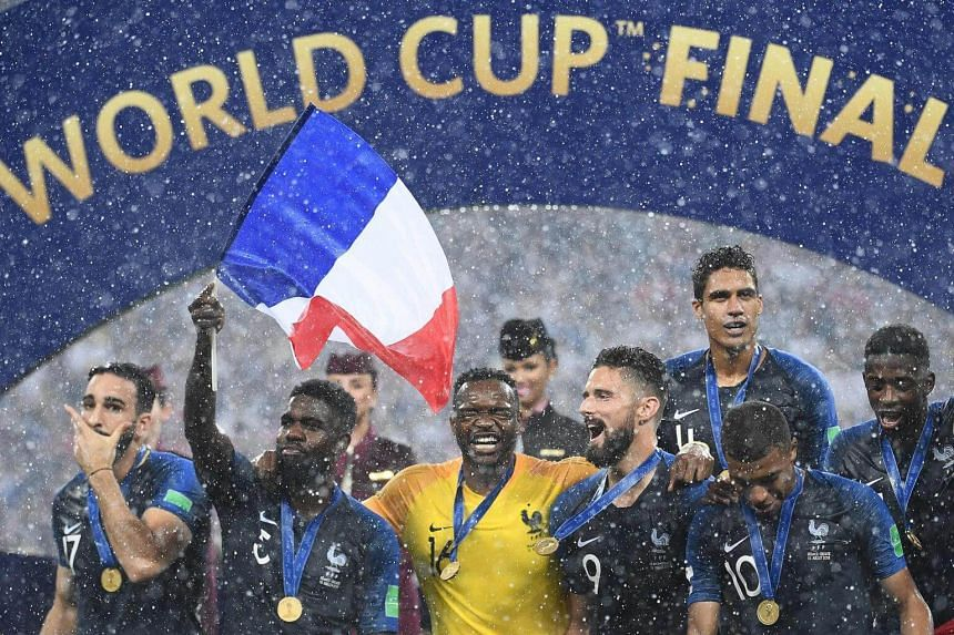 France's players celebrating during the trophy ceremony at the end of the Russia 2018 World Cup final football match between France and Croatia at the Luzhniki Stadium in Moscow, on July 15, 2018.