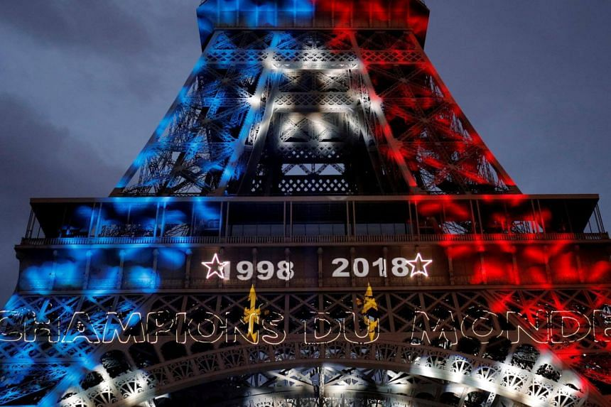 Blue, white, and red lights and two World Cup stars are projected on the Eiffel Tower after France won the Soccer World Cup final on July 15, 2018.