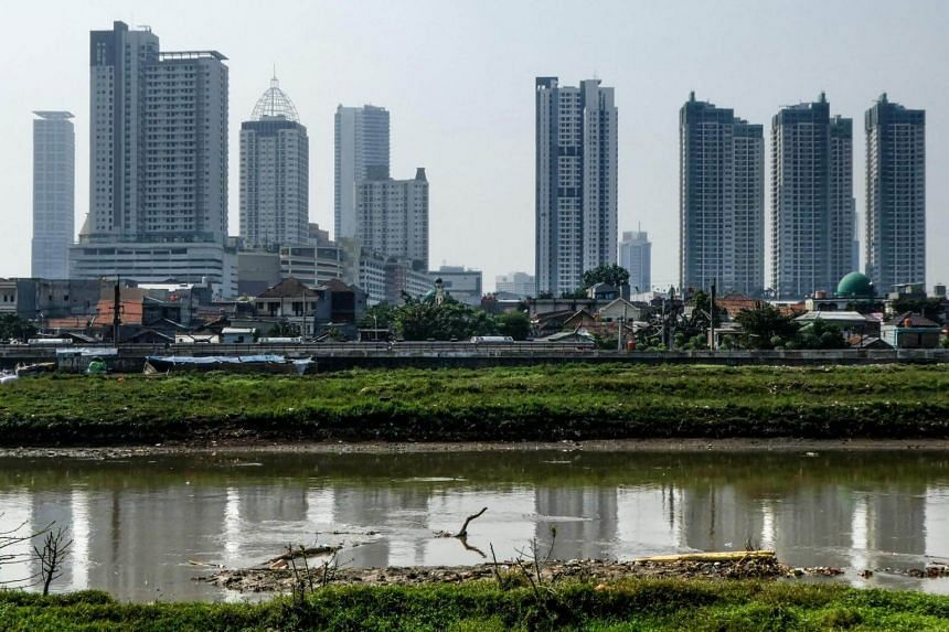 File photo showing the Jakarta skyline. Indonesian policy makers are working to temper expectations around economic growth as focus on securing financial stability amid a slumping rupiah.