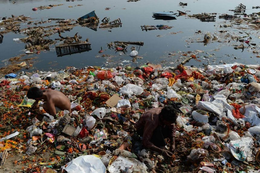 Indian scavengers scouring the polluted the Yamuna river in New Delhi, India. India has made substantial headway towards its water and sanitation goal, but sustaining progress remains a challenge.