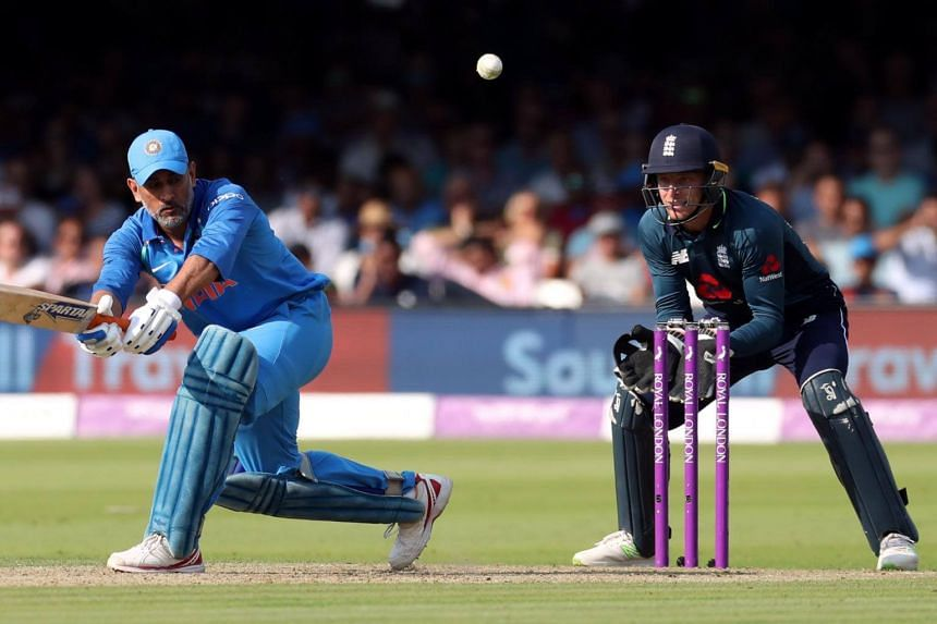 India's MS Dhoni in action as England's Jos Buttler looks on during the Second One Day International at the Lord's Cricket Ground, in London, on July 14, 2018.