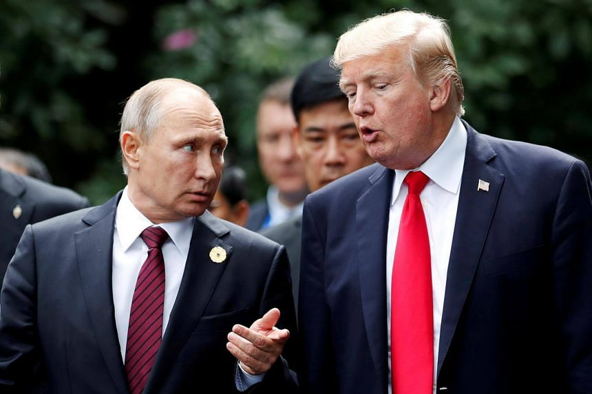 US President Donald Trump and his Russian counterpart Vladimir Putin talk at the Apec summit in Danang, Vietnam on Nov 11, 2017.