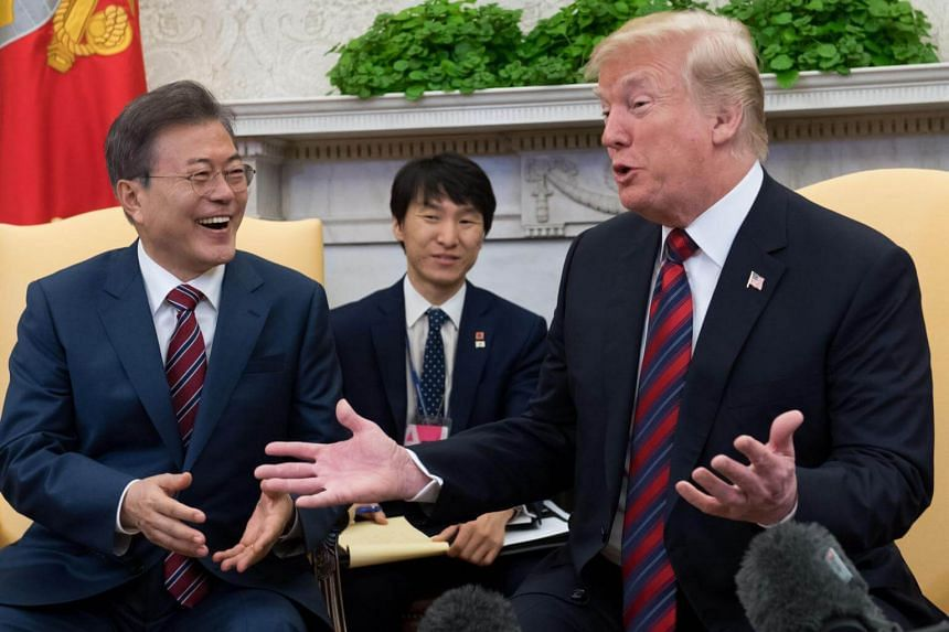 US President Donald Trump and South Korean President Moon Jae In meeting in the White House in Washington, DC, on May 22, 2018.  Trump's tough stance on North Korea makes him seem like an ally to South Korean conservatives.