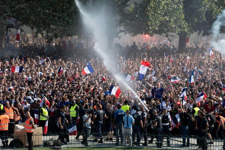 French soccer fans in Paris celebrate after the FIFA World Cup 2018 final soccer match between Croatia and France on July 15, 2018.