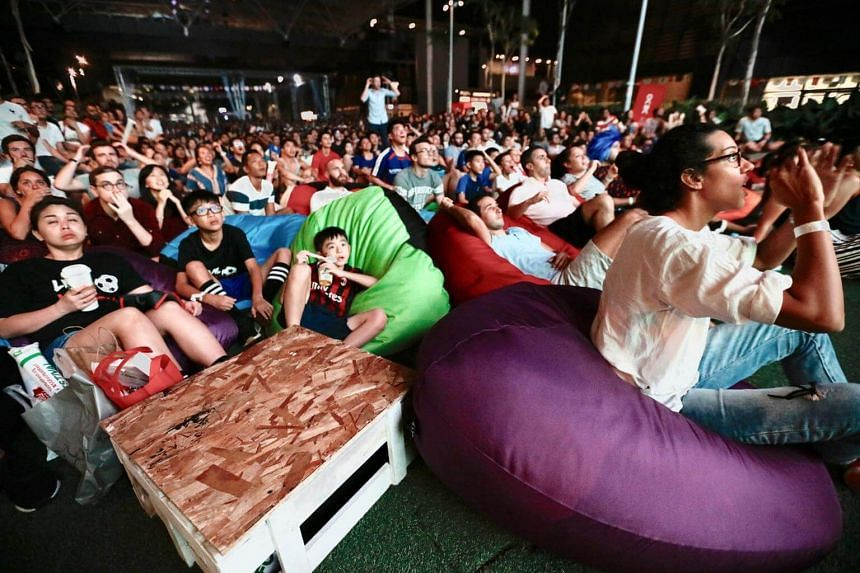 Fans gather at Singapore Sports Hub to catch the World Cup finals between France and Croatia on July 15, 2018.