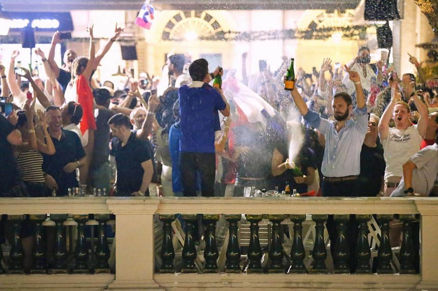 France fans at Chijmes react as their team wins the 2018 World Cup against Croatia on July 15, 2018.