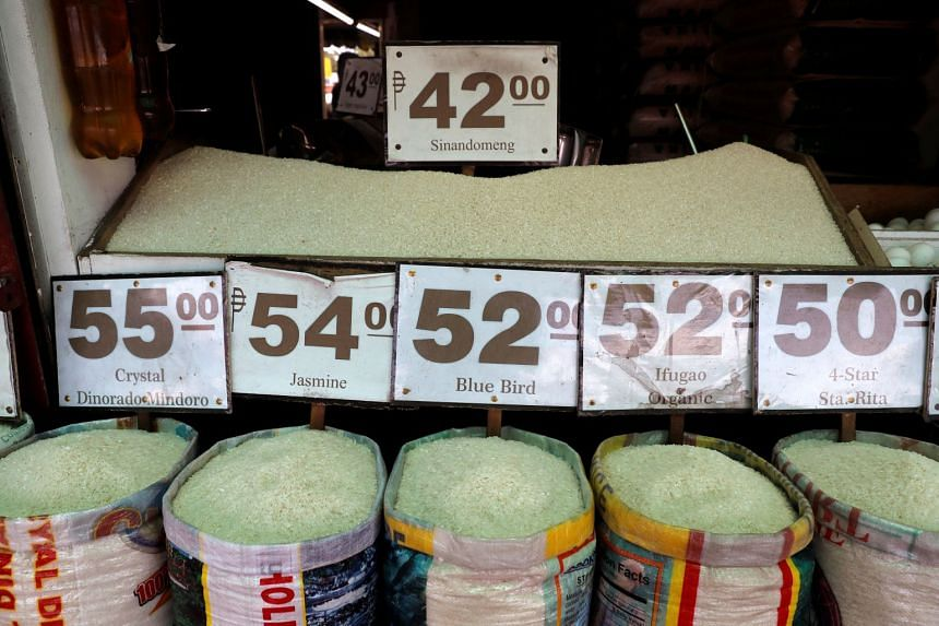 The prices of different varieties of rice are seen at a market in Las Pinas, Metro Manila, on July 5, 2018.
