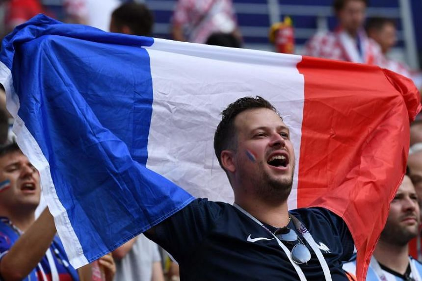 A French supporter cheers his team ahead of the Russia 2018 World Cup final football match between France and Croatia at the Luzhniki Stadium in Moscow on July 15, 2018.