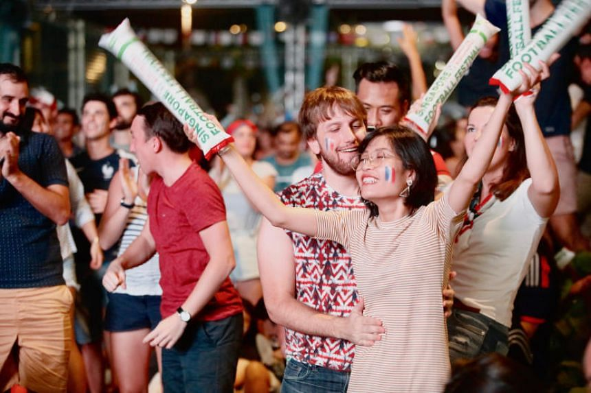 World cups fans gather at Singapore Sports Hub to catch the finals between France and Croatia on July 15, 2018.