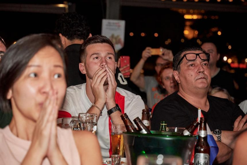 Croatia fans at the Sahara Bar in Boat Quay during the World Cup 2018 final between Croatia and France, on July 16, 2018.