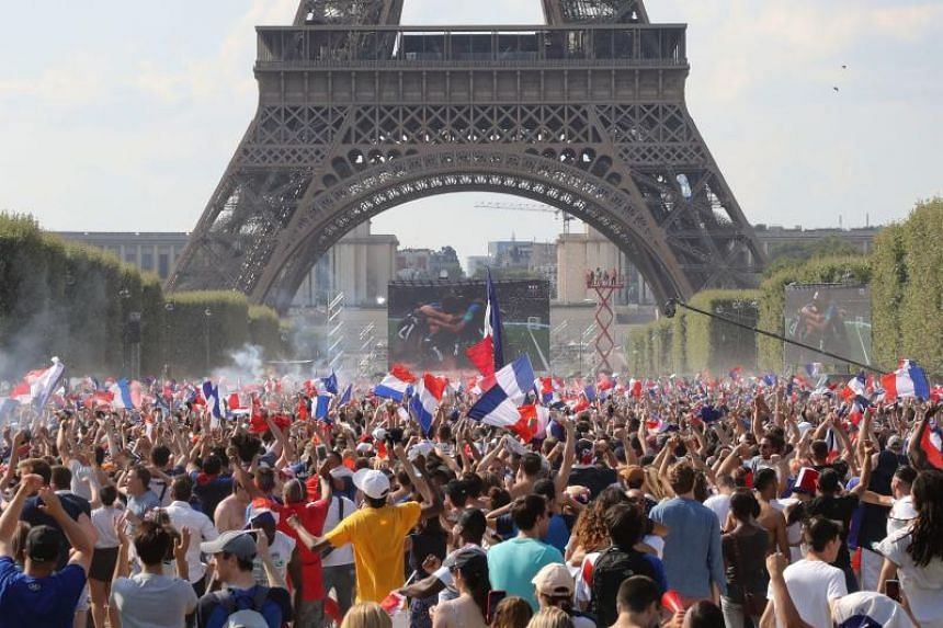 France supporters cheer on the fan zone as they watch the Russia 2018 World Cup final football match between France and Croatia, on the Champ de Mars in Paris on July 15, 2018.