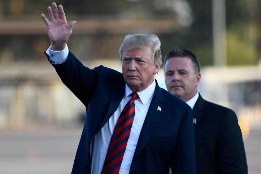 US President Donald Trump waves upon arrival at Helsinki-Vantaa Airport in Helsinki, on July 15, 2018.