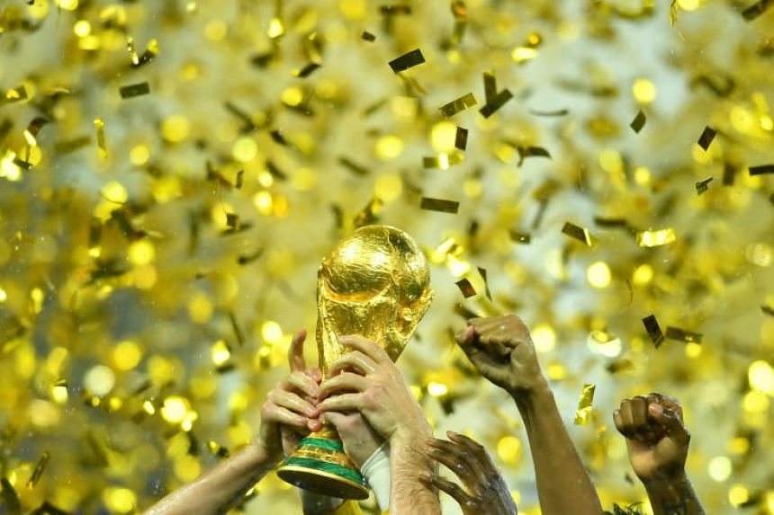 France's goalkeeper Hugo Lloris lifts the World Cup trophy as they celebrate winning the final against Croatia in the Luzhniki Stadium, Moscow, Russia on Jul 15, 2018. PHOTO: REUTERS