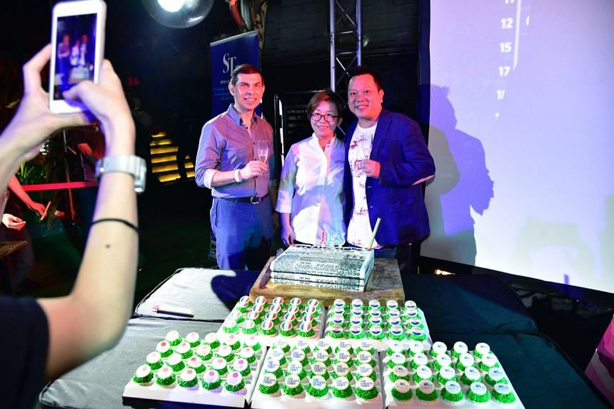 (From left) ST editor Warren Fernandez poses with Ms Jasmin Chew, group pastry chef and Mr Ian Sim, director of nightlife operation at the ST party & World Cup final screening at 1-Altitude.