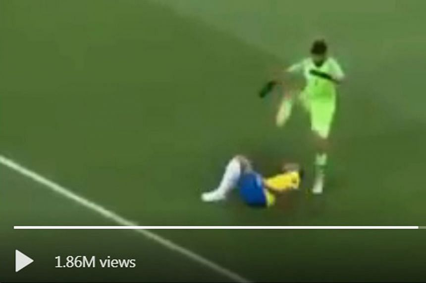 #5 If you ever wondered why VAR decisions take so long, wonder no more. #3 Mohamed Salah gets mummified by Uruguay's Diego Godin and Russia's Aleksandr Golovin after the Egyptians lost their first two matches. Their exit was confirmed by Uruguay's 1-
