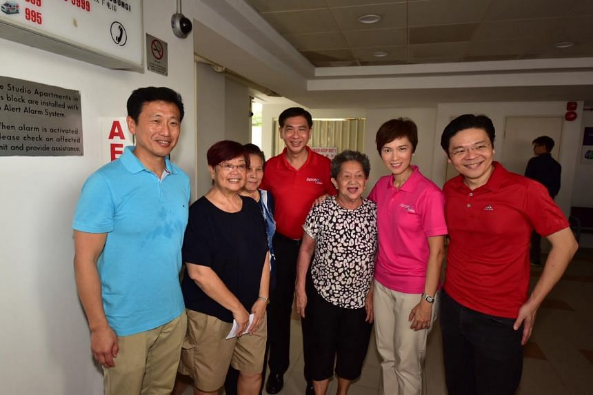 Ministers Ong Ye Kung, Josephine Teo and Lawrence Wong with residents during the ministerial community visit to the Jurong Central Division, on July 15, 2018.