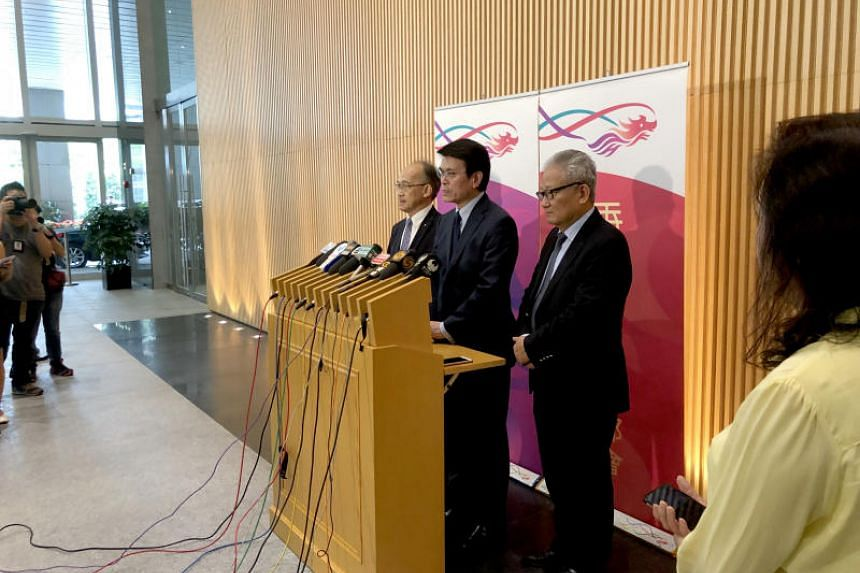 Secretary for Commerce and Economic Development Edward Yau (centre) said the Hong Kong government has in place some financing schemes to assist small and medium-sized enterprises should the need arise.