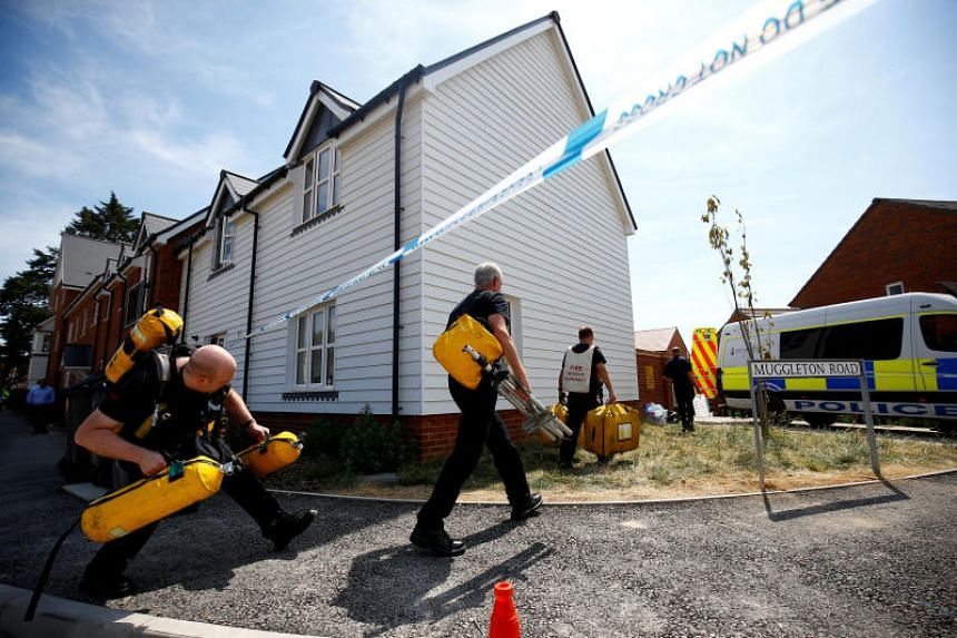 British Fire and Rescue Service personnel arriving with safety equipment at a housing estate on Muggleton Road, after two people were poisoned, on July 6, 2018.