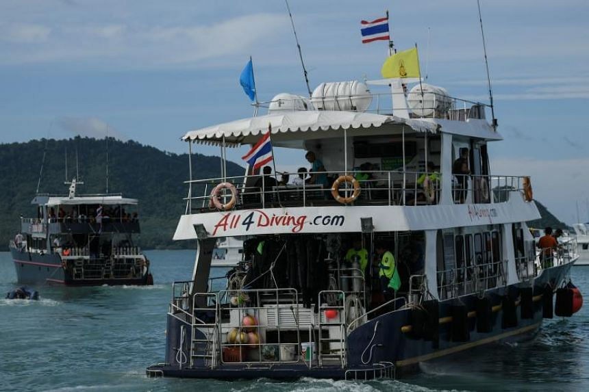 A boat carrying divers leaves Chalong pier on July 7, as rescue operations continue for missing tourists following a boat accident in Phuket, on July 5, 2018.