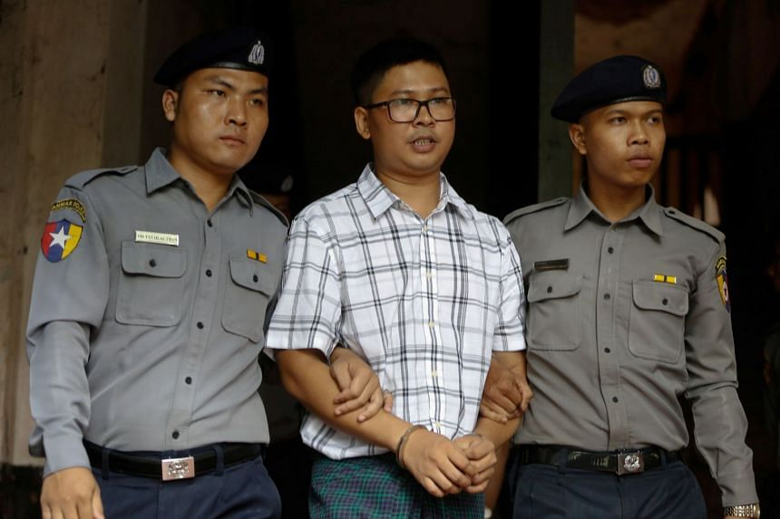 Detained journalist, Wa Lone (middle), was the first to testify and told the court yesterday he had followed standard reporting procedures and not broken any laws.