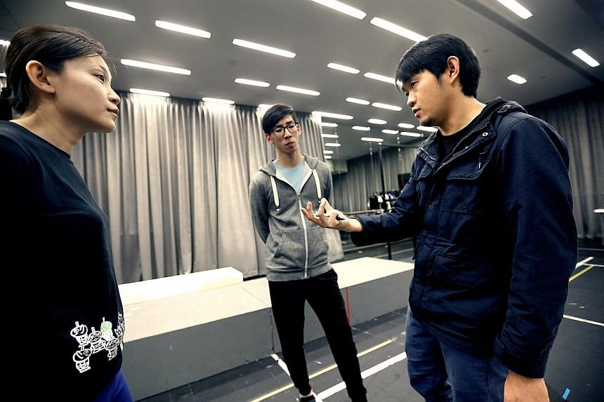(From left) Performers Holene Wong and Darren Guo, and director Stanley Seah at a rehearsal.