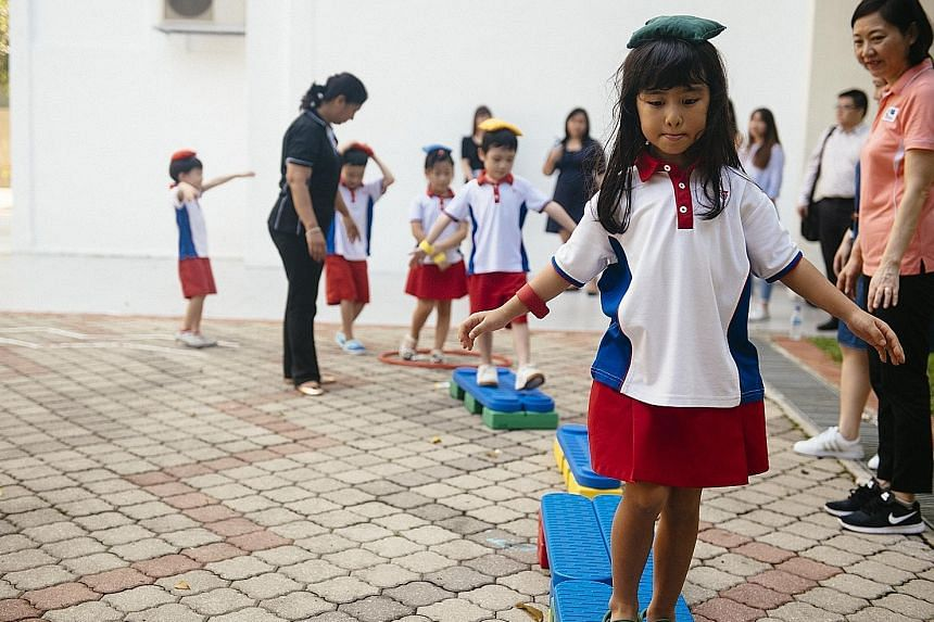 "Pupils at a motor skill development lesson at the PCF Sparkletots Preschool in Ang Mo Kio. The exercise counts towards the criteria for accreditation as a ""healthy pre-school"", along with healthier meals and other requirements."