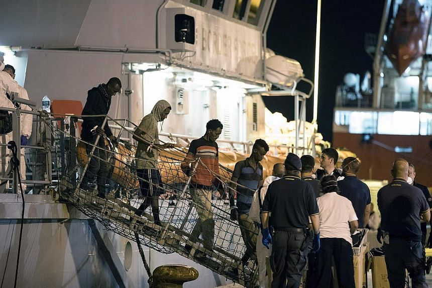 Migrants arriving at the Sicilian port of Pozzallo. The Italian ship Monte Sperone and British naval vessel Protector had picked up 450 asylum seekers from an overcrowded boat that left Libya last Friday.