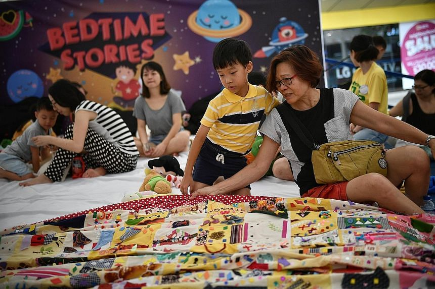 Visitors to an event in Toa Payoh Central could be forgiven for wanting an early night, as it features a mega-sized children's bedroom. Retiree Leong Fong Mei, 66, and her seven-year-old grandson Aegen Chiang were among those who admired a giant patc