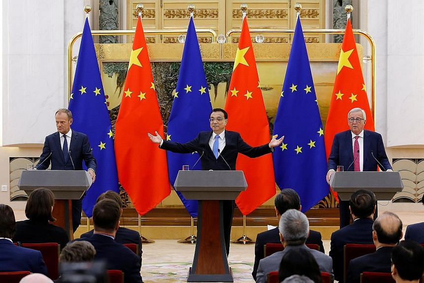 (From left) European Council president Donald Tusk, Chinese Premier Li Keqiang and European Commission president Jean-Claude Juncker at a news conference in Beijing yesterday, after the annual China-EU summit. Mr Li said China would continue to provi