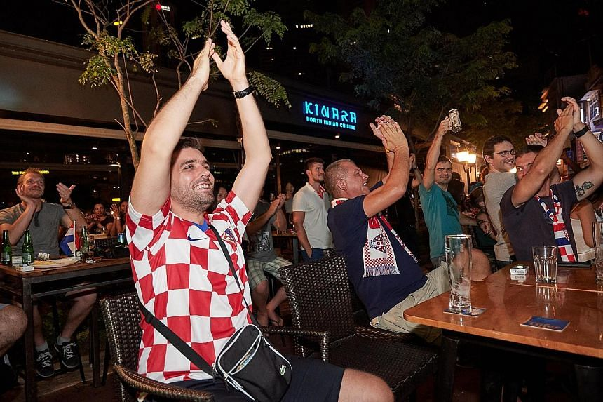 Croatia fans watching the World Cup final at a bar in Boat Quay. This year, 38 of the 64 matches during the month-long tournament were shown before midnight.
