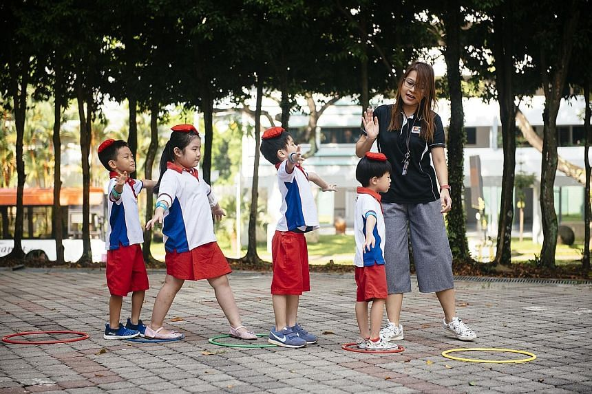 "Pupils at the PAP Community Foundation Sparkletots Preschool in Ang Mo Kio participating in an outdoor physical activity. It is among the growing number of pre-schools accredited as a ""healthy pre-school""."