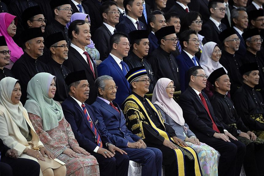 New Speaker Mohamad Ariff Md Yusof (first row, fifth from left) posing for a photo with Malaysian Prime Minister Mahathir Mohamad, Deputy Prime Minister Wan Azizah Wan Ismail, other Cabinet ministers and MPs at the swearing-in of the new Parliament.