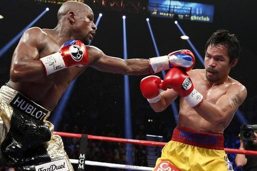 Manny Pacquiao (right) and Floyd Mayweather Jr during their welterweight unification bout, on May 2, 2015. Pacquiao has called on Mayweather for a rematch.