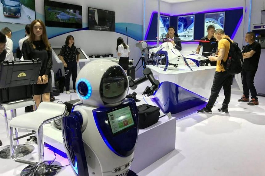 A police robot that can scan faces is seen on display at the China International Exhibition on Police Equipment in Beijing, on May 15, 2018. China is expected to advance in the rankings in artificial intelligence soon.