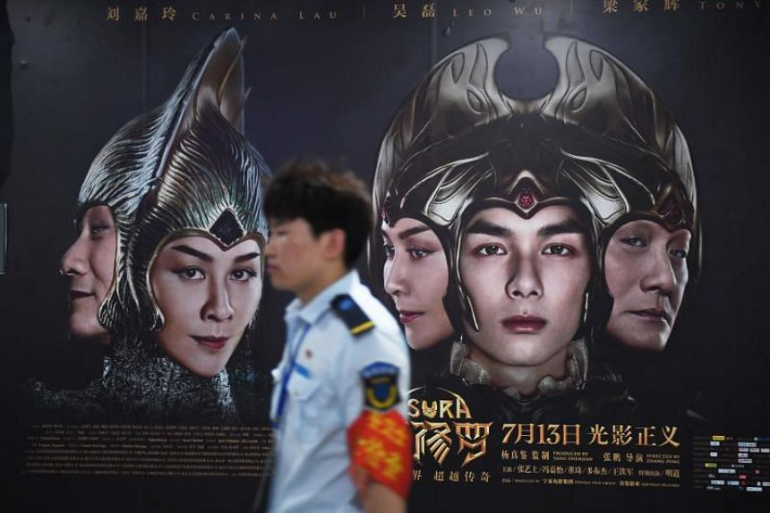 Posters for the movie Asura at a subway station in Beijing on July 17, 2018.