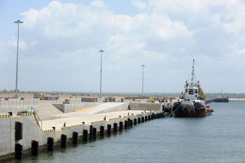 A barge is berthed at the new port in Hambantota, Sri Lanka, in 2011.