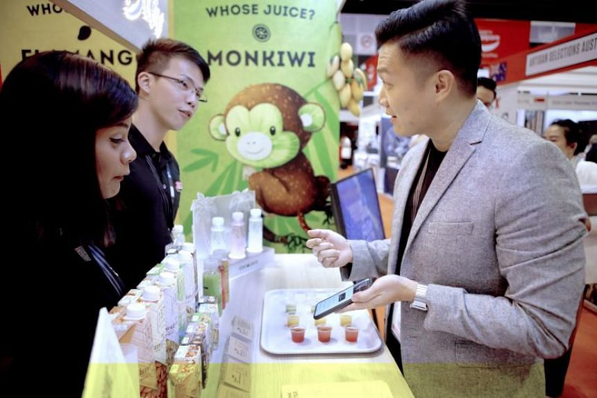 Whose Juice founder Kevin Ngian (right) giving a demonstration to his staff.