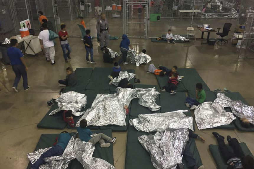 An intake of illegal border crossers by US Border Patrol agents at the Central Processing Center in McAllen, Texas, on June 17, 2018.