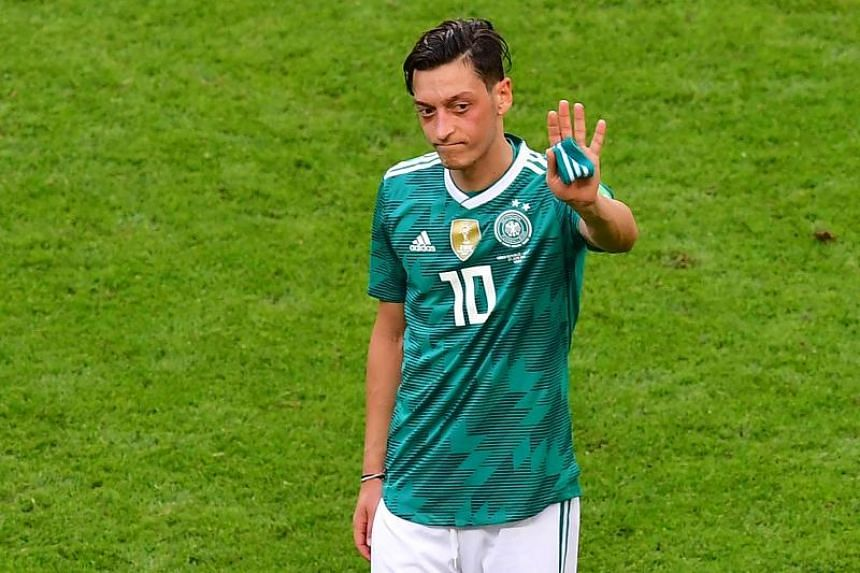 Germany's midfielder Mesut Ozil reacts at the end of the Russia 2018 World Cup Group F football match between South Korea and Germany at the Kazan Arena in Kazan on, June 27, 2018.