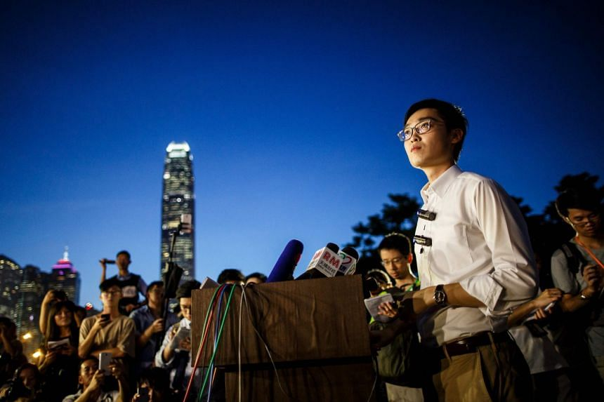 File photo showing Andy Chan (right), leader of the pro-independence Hong Kong National Party and a disqualified candidate of the city's elections, speaking at a press conference at the start of a rally near the government's headquarters in Hong Kong