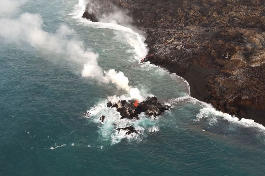 This image obtained on July 13, 2018, from the US Geological Survey, shows a tiny new island of lava in the ocean near Hawaii.