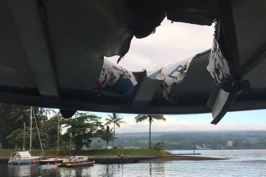 A handout photo made available by the Hawaii Department of Land and Natural Resources shows a hole in the roof of a boat after it was hit by a 'lava bomb'.