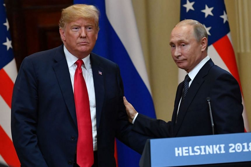US President Donald Trump (left) and Russia's President Vladimir Putin leave at the end of a joint press conference after a meeting at the Presidential Palace in Helsinki, on July 16, 2018.