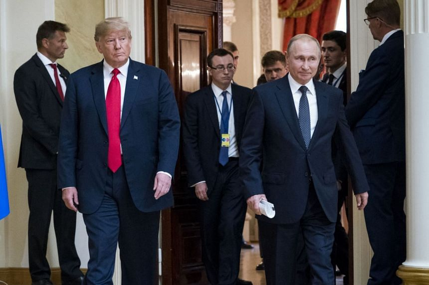 US President Donald Trump (left) and President Vladimir Putin of Russia arrive at a joint news conference in Helsinki, Finland, on July 16, 2018.