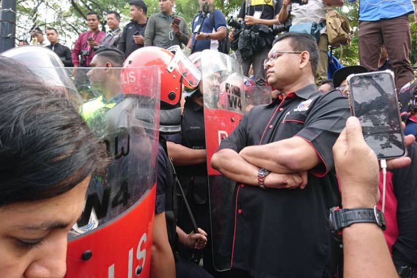Police stopping a demonstration staged by by Umno members who were trying to  march to Parliament from Bukit Aman on Tuesday morning (July 17).