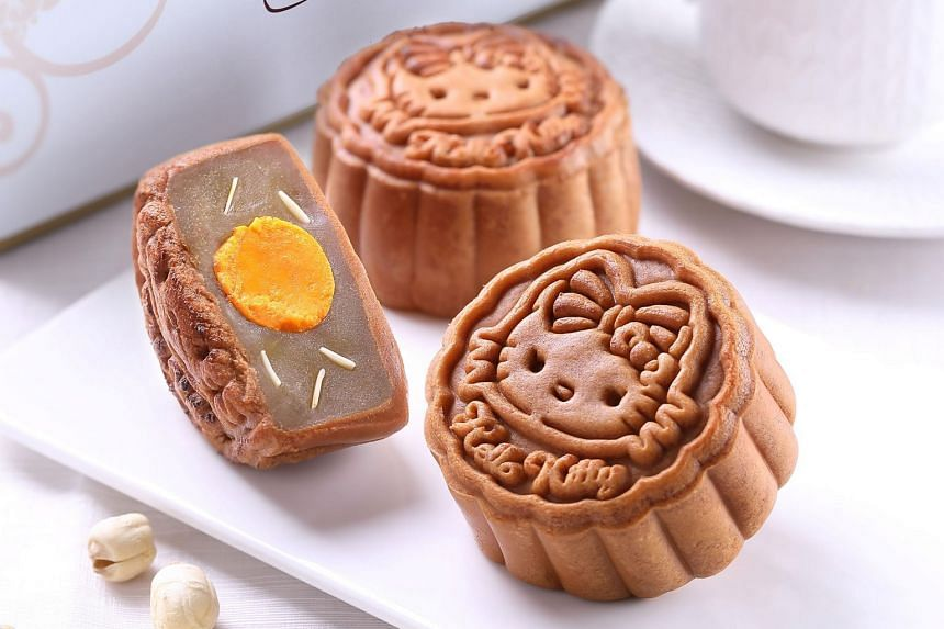 The Over The Moon flavour is filled with a salted egg yolk enveloped in smooth lotus seed paste and lotus seeds.