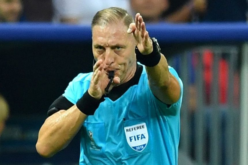 Referee Nestor Pitana calls for a penalty after a VAR review. Croatia coach Zlatko Dalic believes the spot kick should not have been given.