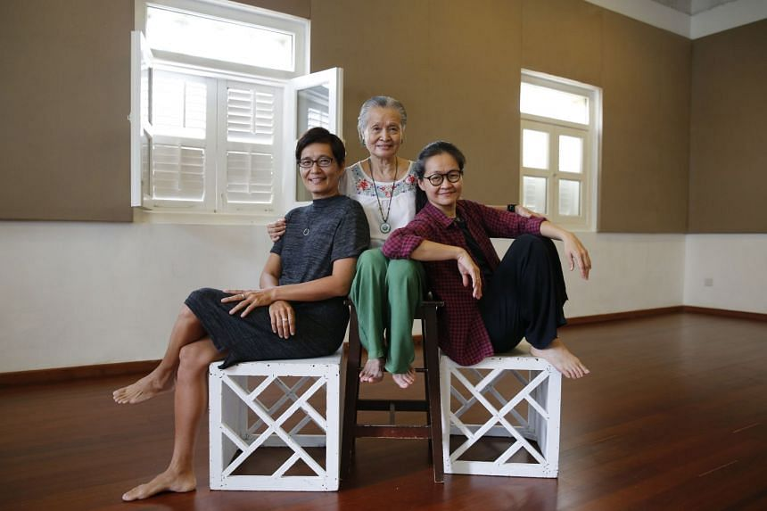 The Theatre Practice's artistic director Kuo Jian Hong (far left), with her sister Okorn-Kuo Jing Hong (left) and their mother, Goh Lay Kuan.